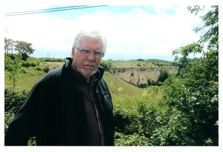 Barry in front of The Falaise Gap where his father died, in Haut-Mesnil, on the 70th anniversary in